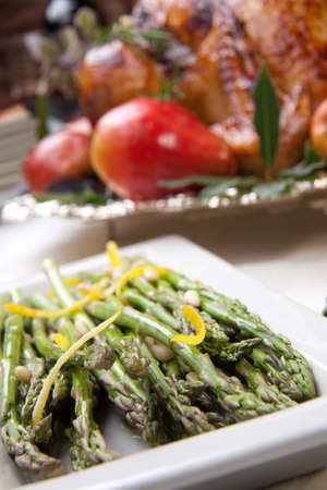 pine nuts: Asparagus with lemon sause and pine nuts Stock Photo