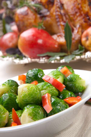 Closeup of brusssels sprouts with roasted bell pepper.  photo