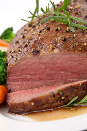 Roasted beef loin tri-tip, garnished with vegetables photo