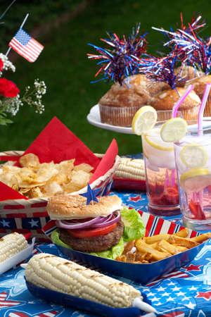 Cornbread, corn and burgers on 4th of July picnic in patriotic theme Stock Photo - 9741153