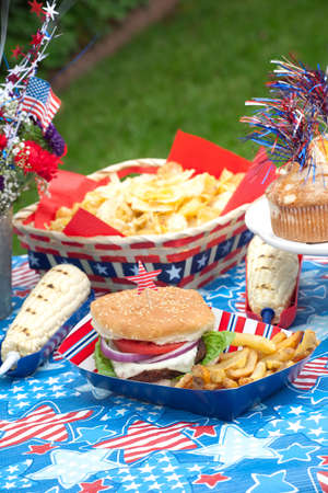 Cornbread, corn and burgers on 4th of July picnic in patriotic theme Stock Photo - 9743059