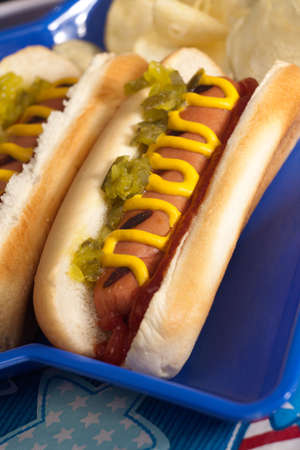 hot food: Cornbread and hot dogs on 4th of July in patriotic theme Stock Photo