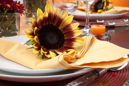 arrangment: Harvest festive dinner table setting with sunflowers.