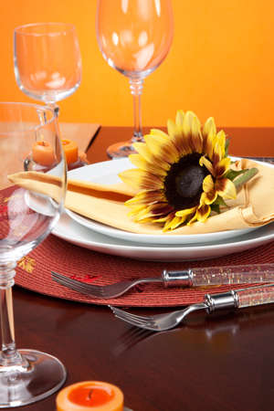 Harvest festive dinner table setting with sunflowers. Stock Photo - 10288871