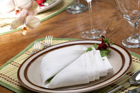 arrangment: Exotic theme table setting. Arrangments with fresh fern and kangaroo paws flower Stock Photo
