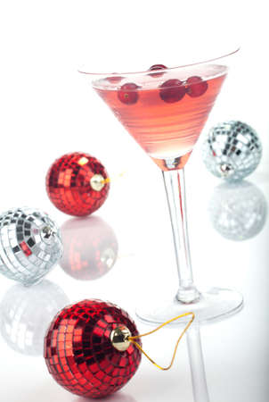 Close up of glass of Limomcello Cosmo Cocktail over white, arranged Christmas ornament. Most popular cocktails series. Stock Photo - 10627279