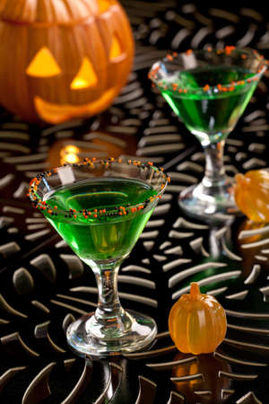 Closeup of Witch Blood Martini, vodka, gin, vermouth, and liquor - Halloween drinks series photo