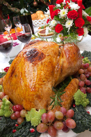 Holiday-decorated table, Christmas tree, champagne, and roasted turkey. Stock Photo - 11007581