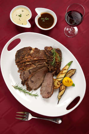Herbed Rib Eye with grilled vegetables and two sauces. photo