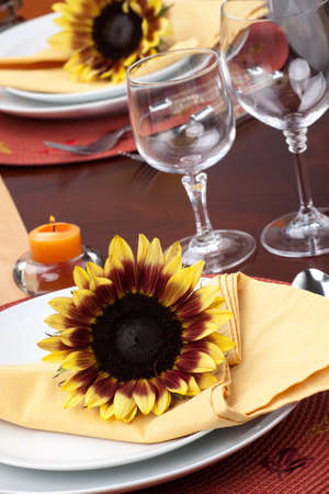 Harvest festive dinner table setting with sunflowers.