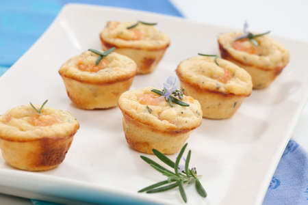 sweet and savoury: Closeup of fresh backed homemade mini shrimp and rosemary muffins