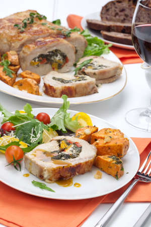 pork loin: Feta-, spinach-, and bell pepper - stuffed pork tenderloin roulade garnished with sweet potato and green salad.