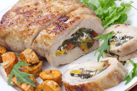 roulade: Feta-, spinach-, and bell pepper - stuffed pork tenderloin roulade garnished with sweet potato and green salad.
