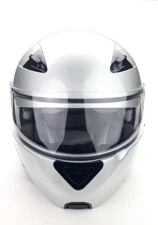 High quality light gray motorcycle helmet over white background, studio isolated. Фото со стока