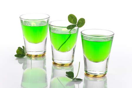 Row of green liquor shots for St Patrick