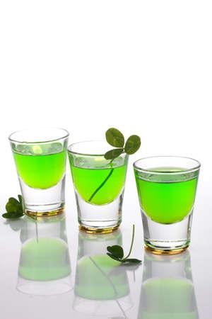 clovers: Row of green liquor shots for St Patrick