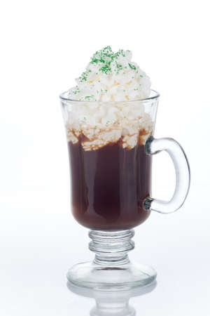 Mug of Irish Coffee with green sprinkles for St Patrick photo