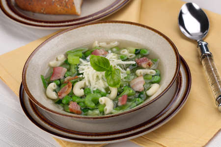 Closeup of bowl of hot fresh Minestrone soup and cheese garlic breadsticks Stock Photo - 11992606