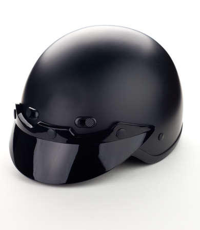 High quality light gray motorcycle helmet over white background, studio isolated. photo