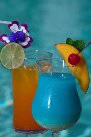 blue hawaiian drink: Blue Hawaiian and Mai Tai cocktails on swimming pool side