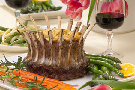 stuffing: Crown roast of lamb with apple rosemary stuffing  Garnished with asparagus, glazed carrots, and rosemary twigs  Side dishes - asparagus, and beans