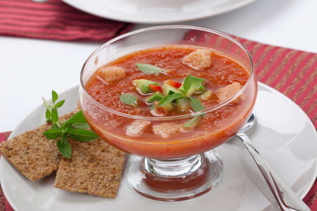 Closeup of bowl of delicious cold Gazpacho soup with cucumber - avocado salsa  Good summer time appetizer  photo