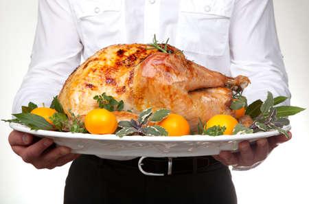 Garnished citrus glazed roasted turkey on platter is ready to be served Reklamní fotografie