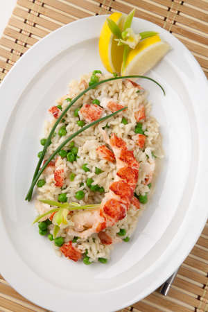 risotto: Lobster and green pea Risotto garnished with chives, lemon, and orchid flower