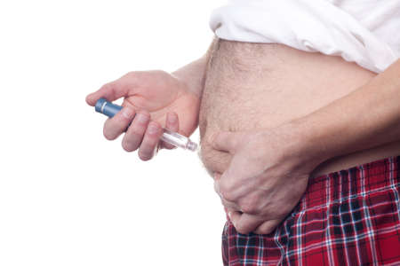 insulin syringe: Overweight fat man with diabetes gets an insulin injection in abdomen area over white background