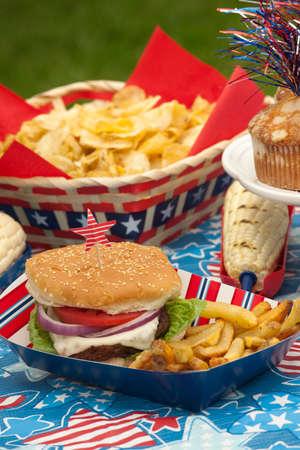 Cornbread, corn and burgers on 4th of July picnic in patriotic theme Stock Photo - 13419128