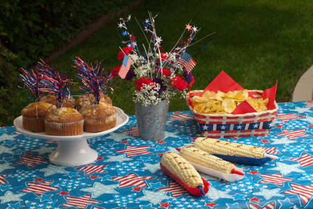 fourth of july: Cornbread, corn and burgers on 4th of July picnic in patriotic theme