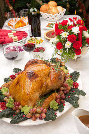 stuffing: Holiday-decorated table, Christmas tree, champagne, and roasted turkey