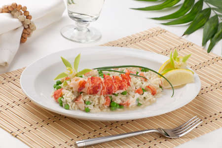 green pea: Lobster and green pea Risotto garnished with chives, lemon, and orchid flower