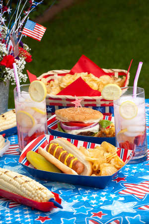 cornbread: Hot dogs, corn and burgers on 4th of July picnic in patriotic theme Stock Photo