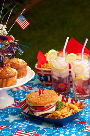Cornbread, corn and burgers on 4th of July picnic in pattic theme Stock Photo - 13616680