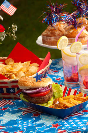 Cornbread, corn and burgers on 4th of July picnic in patriotic theme Stock Photo - 13642874