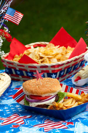 Cornbread, corn and burgers on 4th of July picnic in patriotic theme