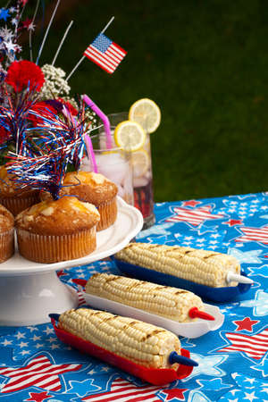 Cornbread, corn and burgers on 4th of July picnic in patriotic theme Stock Photo - 13817422