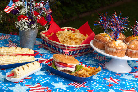 Cornbread, corn and burgers on 4th of July picnic in patriotic theme Stock Photo - 13919781
