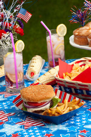 Cornbread, corn and burgers on 4th of July picnic in patriotic theme Stock Photo - 13919756