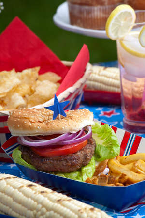 Cornbread, corn and burgers on 4th of July picnic in patriotic theme Stock Photo - 14009988