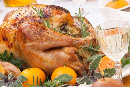 roasted turkey: Garnished citrus glazed roasted turkey on holiday table, pumpkins, flowers, and white wine