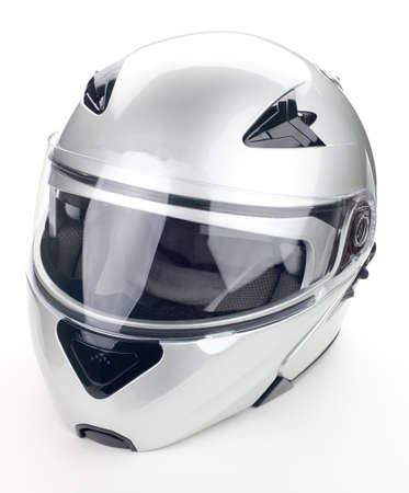 High quality light gray motorcycle helmet over white background, studio isolated.