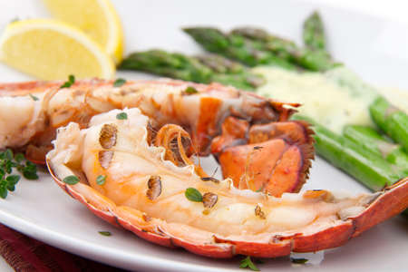 lobster tail: Closeup of delicious grilled lobster tails served with asparagus and bearnaise sauce