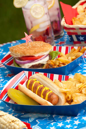 fourth of july: Hot dogs, corn and burgers on 4th of July picnic in patriotic theme Stock Photo