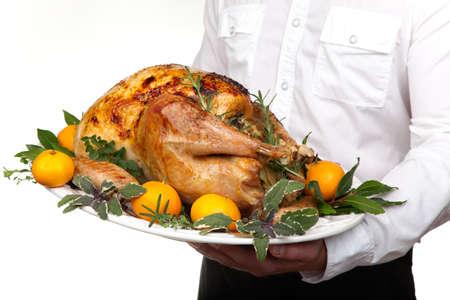 roasted turkey: Garnished citrus glazed roasted turkey on platter is ready to be served Stock Photo