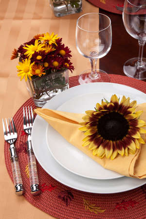 Harvest festive dinner table setting with sunflowers  photo