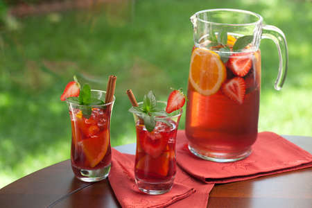 Closeup of two glass of spicy strawberry Sangria on outside table Stock Photo - 14650705