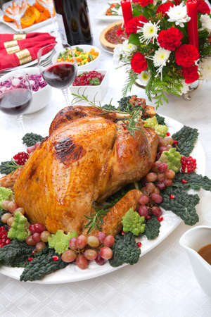 feast: Holiday-decorated table, Christmas tree, champagne, and roasted turkey
