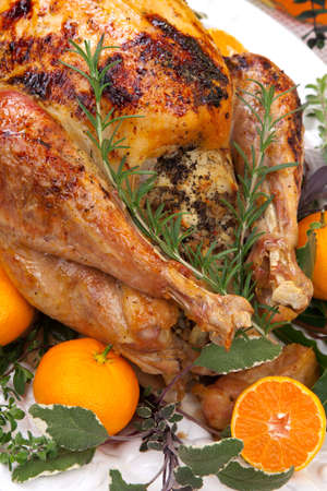 Garnished citrus glazed roasted turkey on holiday table, pumpkins, flowers, and white wine Stock Photo - 15511020